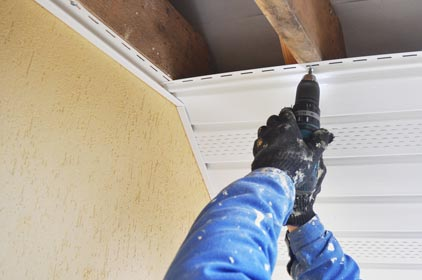 repairing damaged roof trim